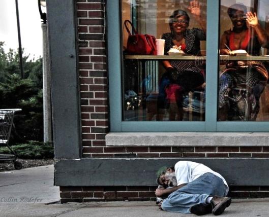 homeless-man-sleeps-outside-a-diner-in-milwaukee